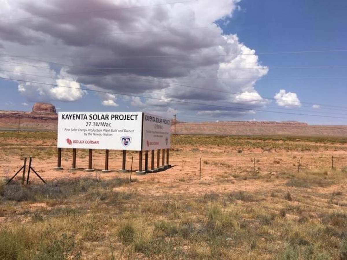 "a billboard reading ""kayenta solar project, 27.3MWac"" in a desert"