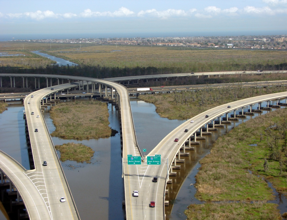 an interstate highway over wetlands. new orleans is in the background