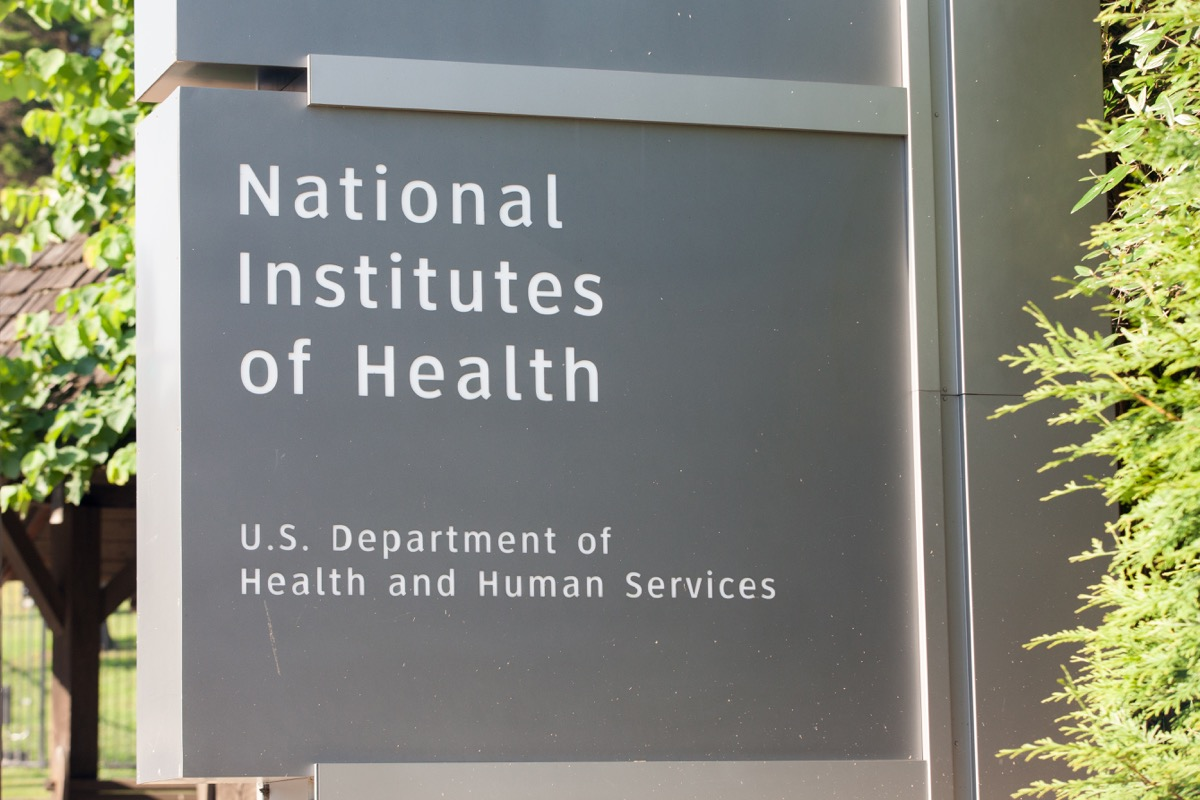 a grey sign stating the name of the national institutes of health outside washington dc