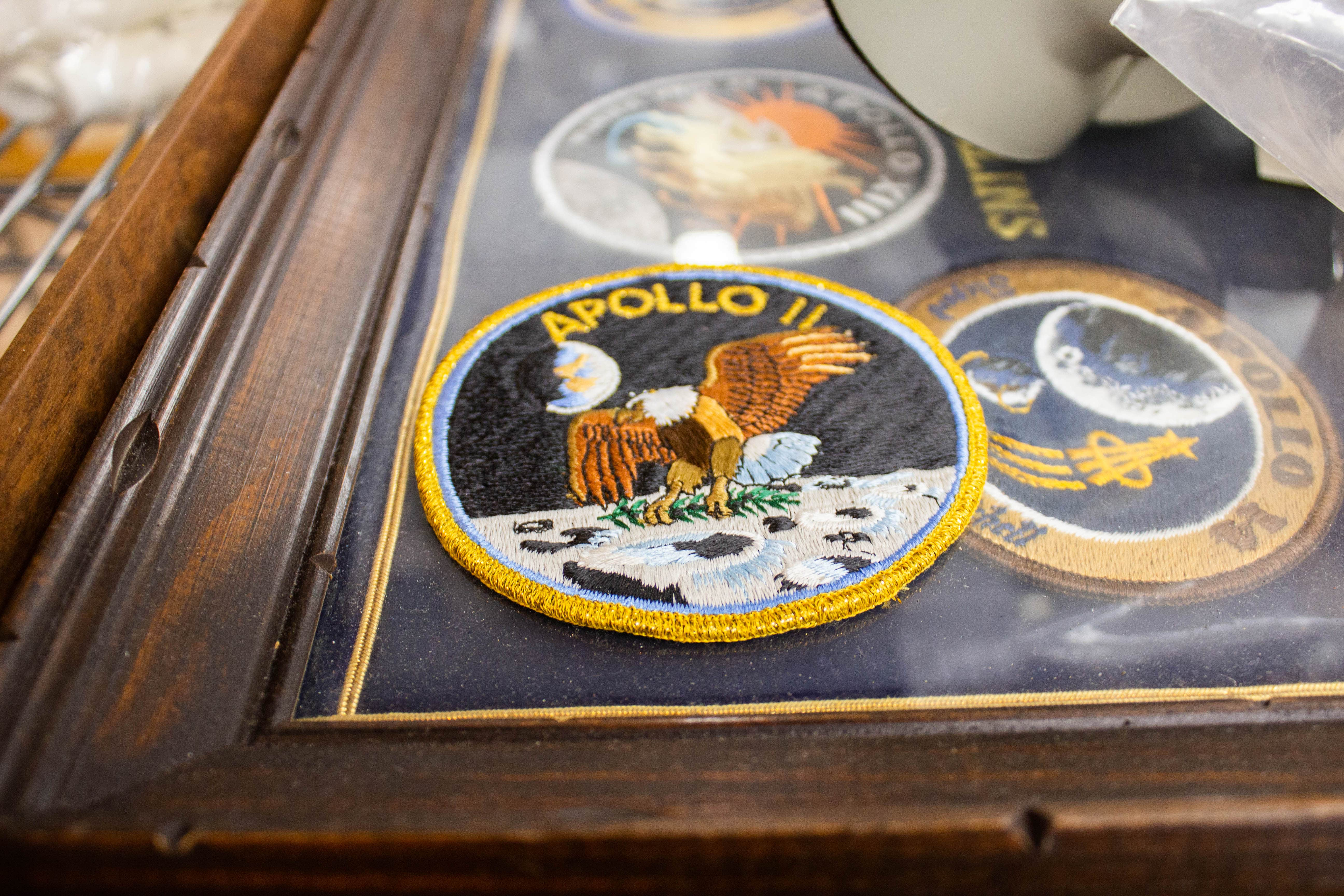 circular patch featuring an eagle on a navy background on the moon