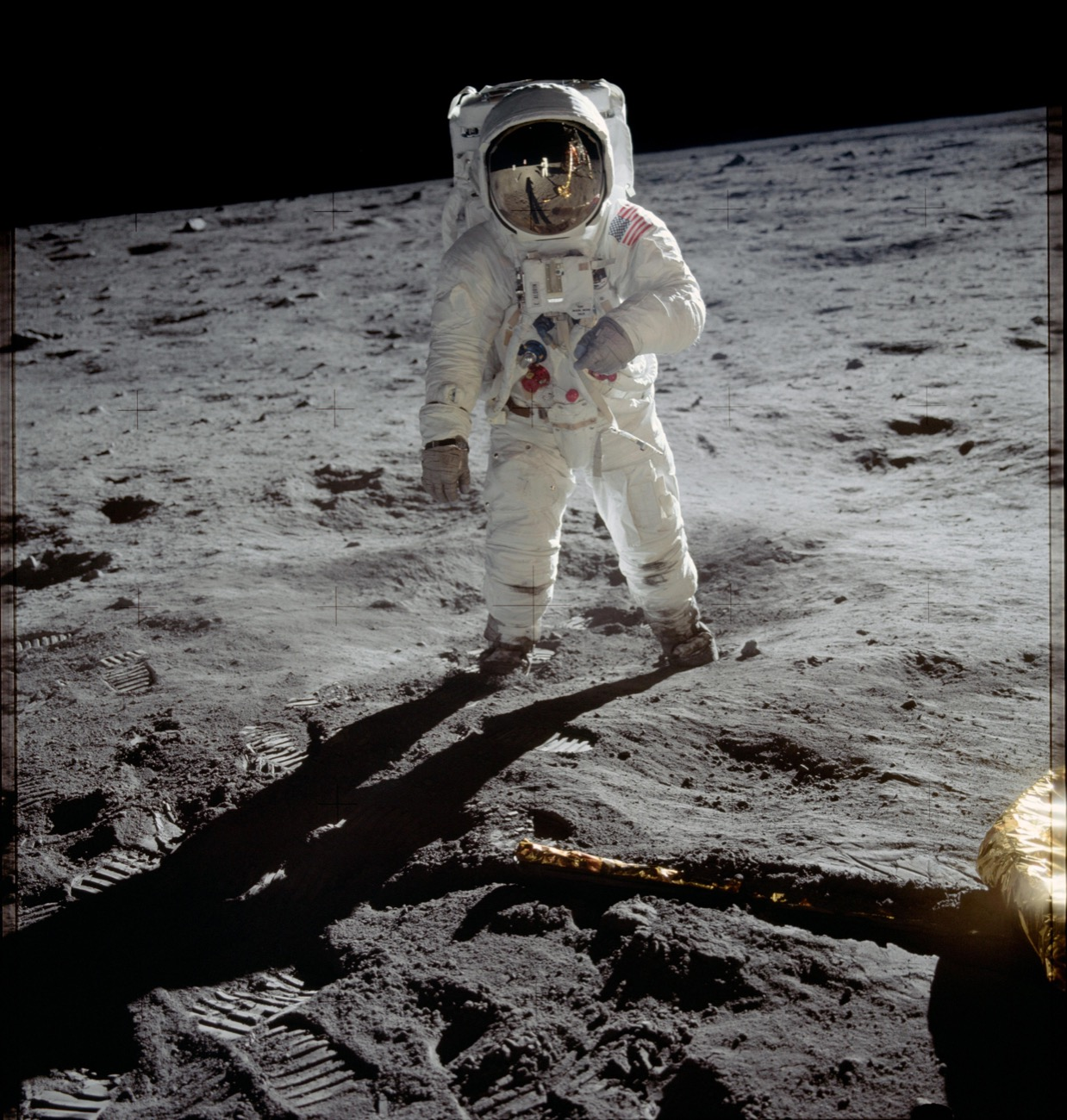 an astronaut stands on the moon