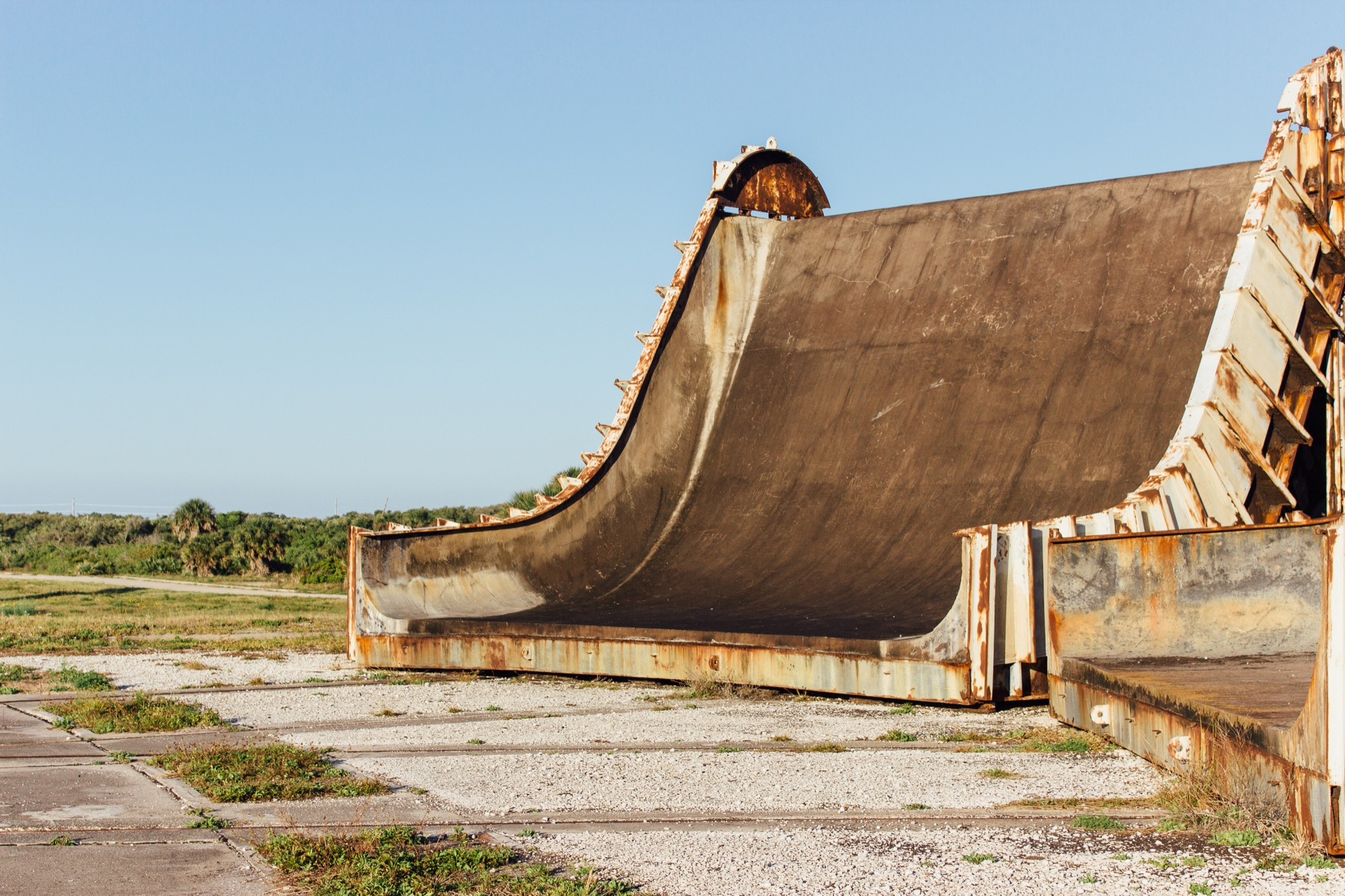 a rusting large concrete ramp structure