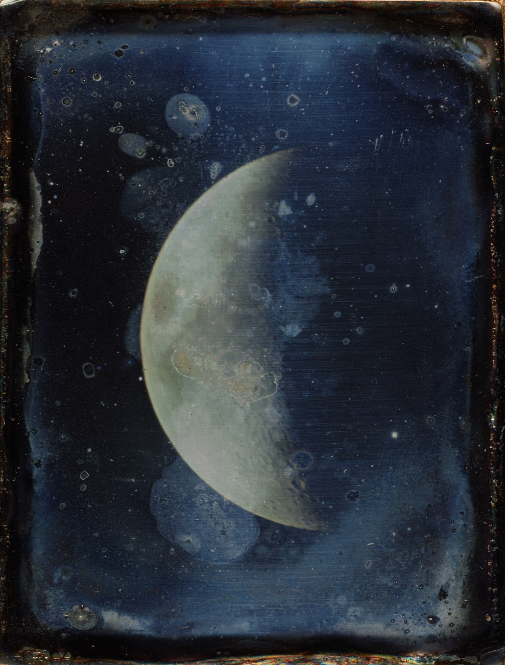 a faded photograph of the moon half obscured in shadow