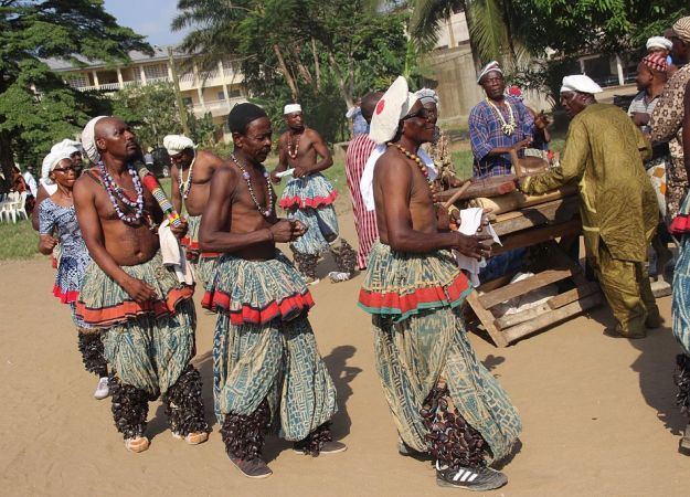 Bamileke dancers in camaroon dance in a circle in traditional costume