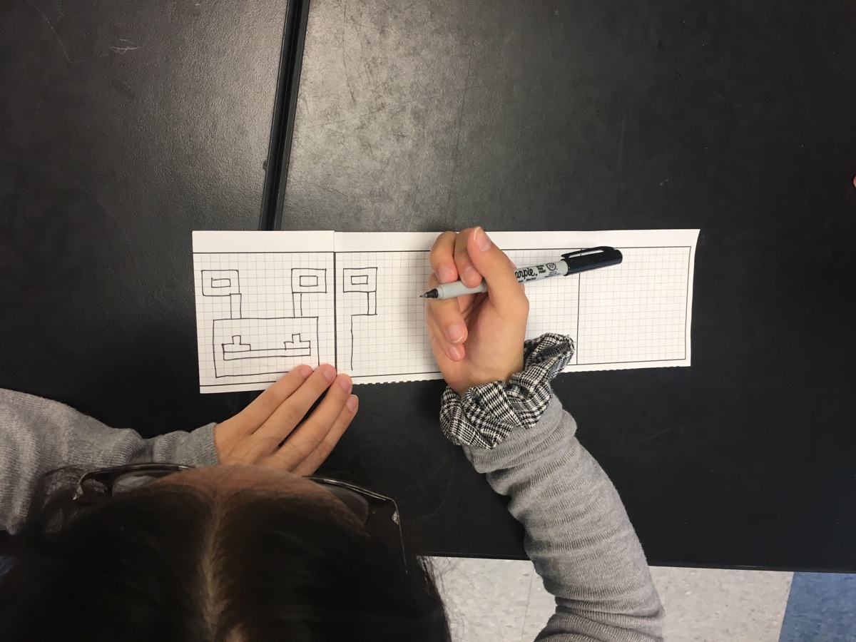 overhead shot of a student drawing their alien