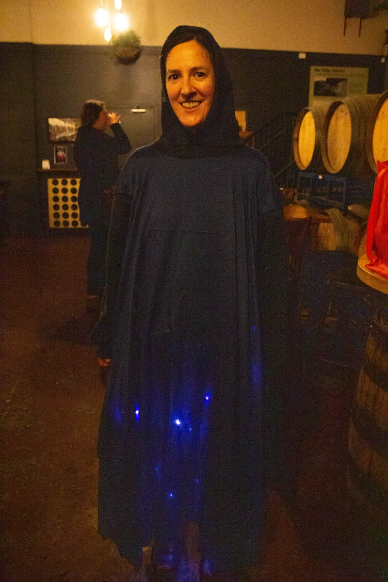 a woman in a blue sheet and blue lights represents a blue ghost firefly