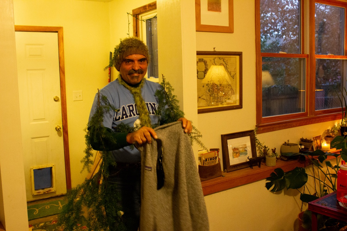 a man dressed as a hemlock by using pieces of the tree and putt it on himself