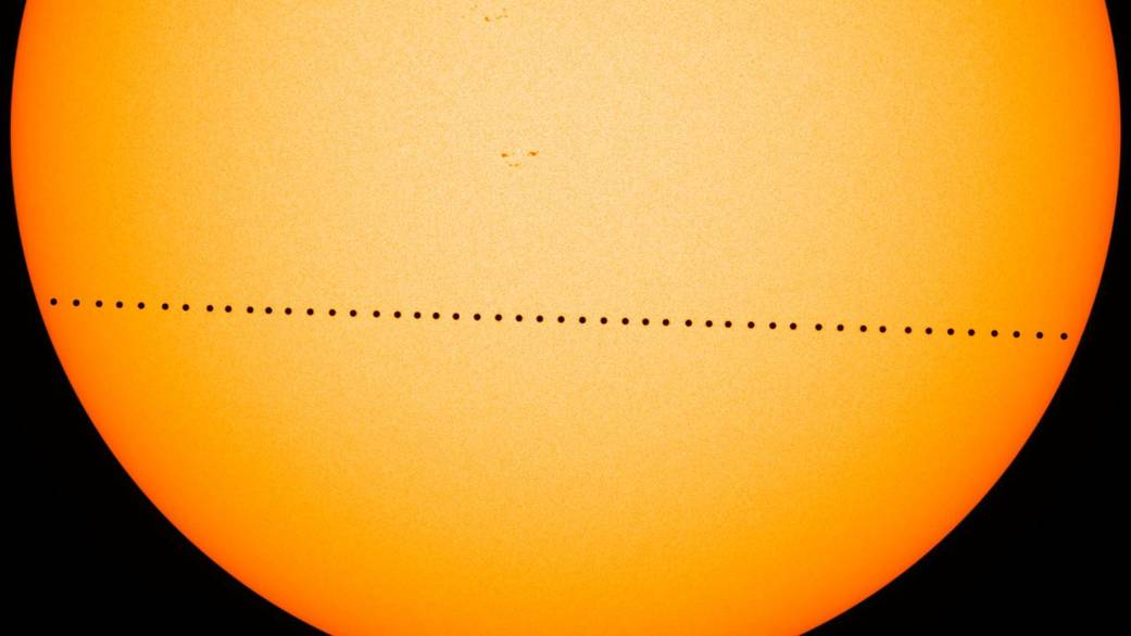 a time lapse image showing the transit of mercury across the sun