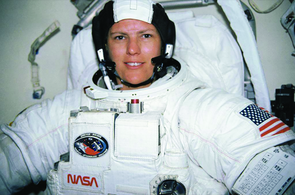 a woman in an astronaut suit