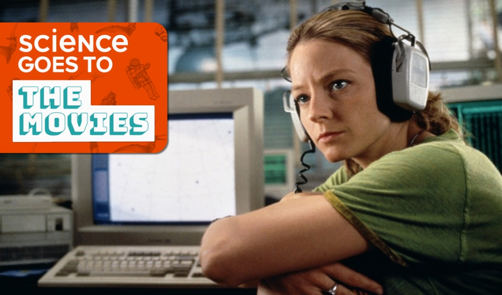"an image of jodie foster wearing large headphones in front of a computer monitor, in character as doctor eleanor arroway in contact, with a small orange box with the words ""science goes to the movies"""
