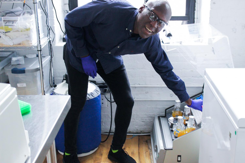 Man using laboratory equipment.