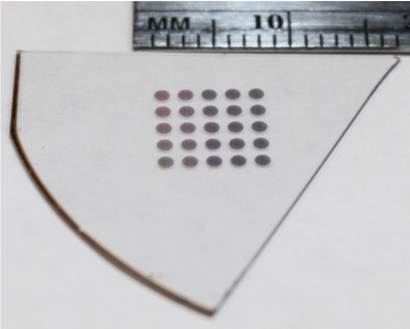 a grid of dots on a clear substrate. they are smaller than 10 millimeters