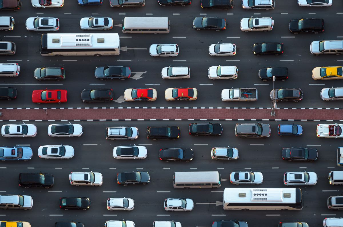an aerial view of two lanes of traffic with bumper to bumper vehicles