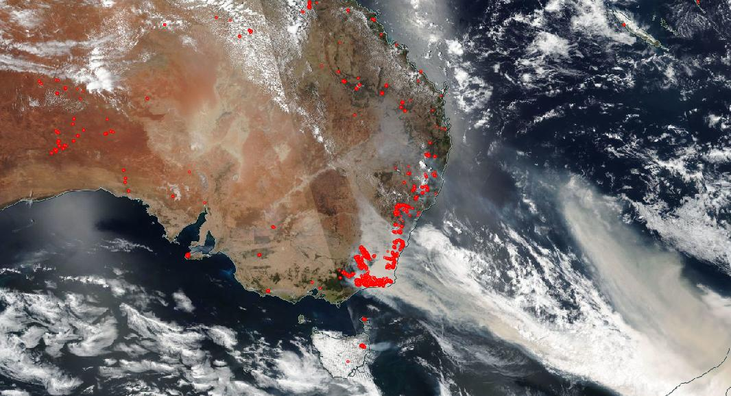 a satellite image taken over australia shows the smoke from the fires