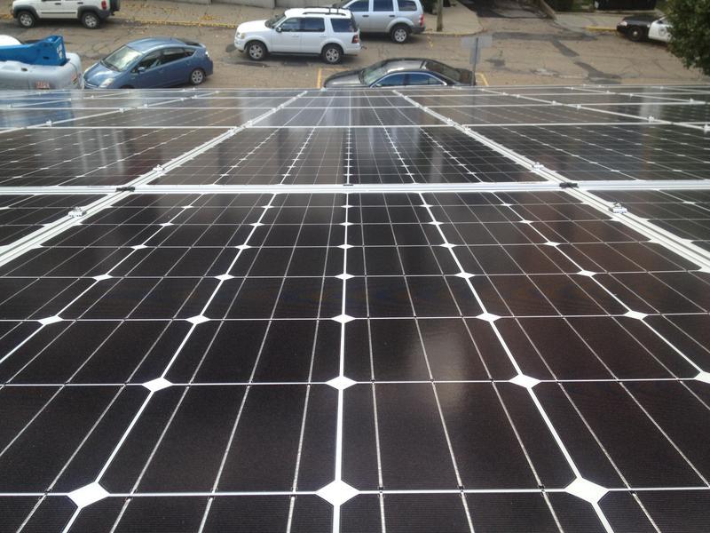 looking down at slanted solar panels.