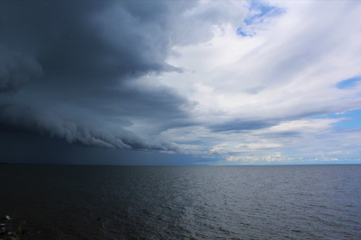 a storm brews over an expansive lake