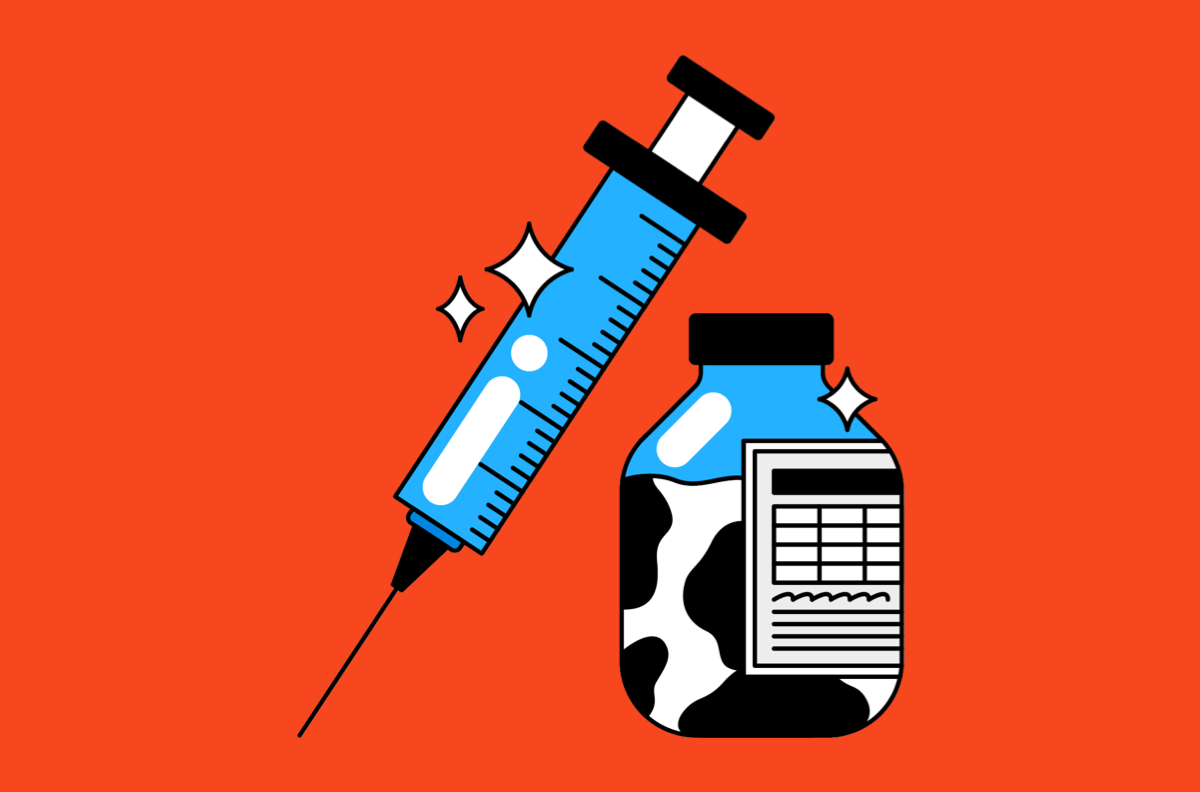 bottle filled with cow colored liquid and syringe on red background