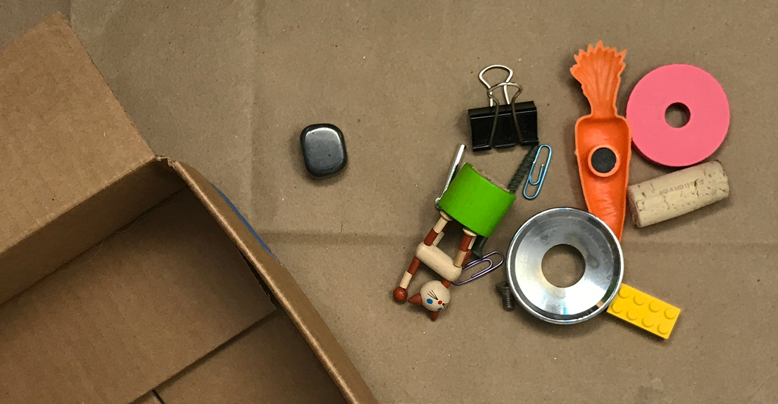 A mix of small toys and random metal and plastic objects