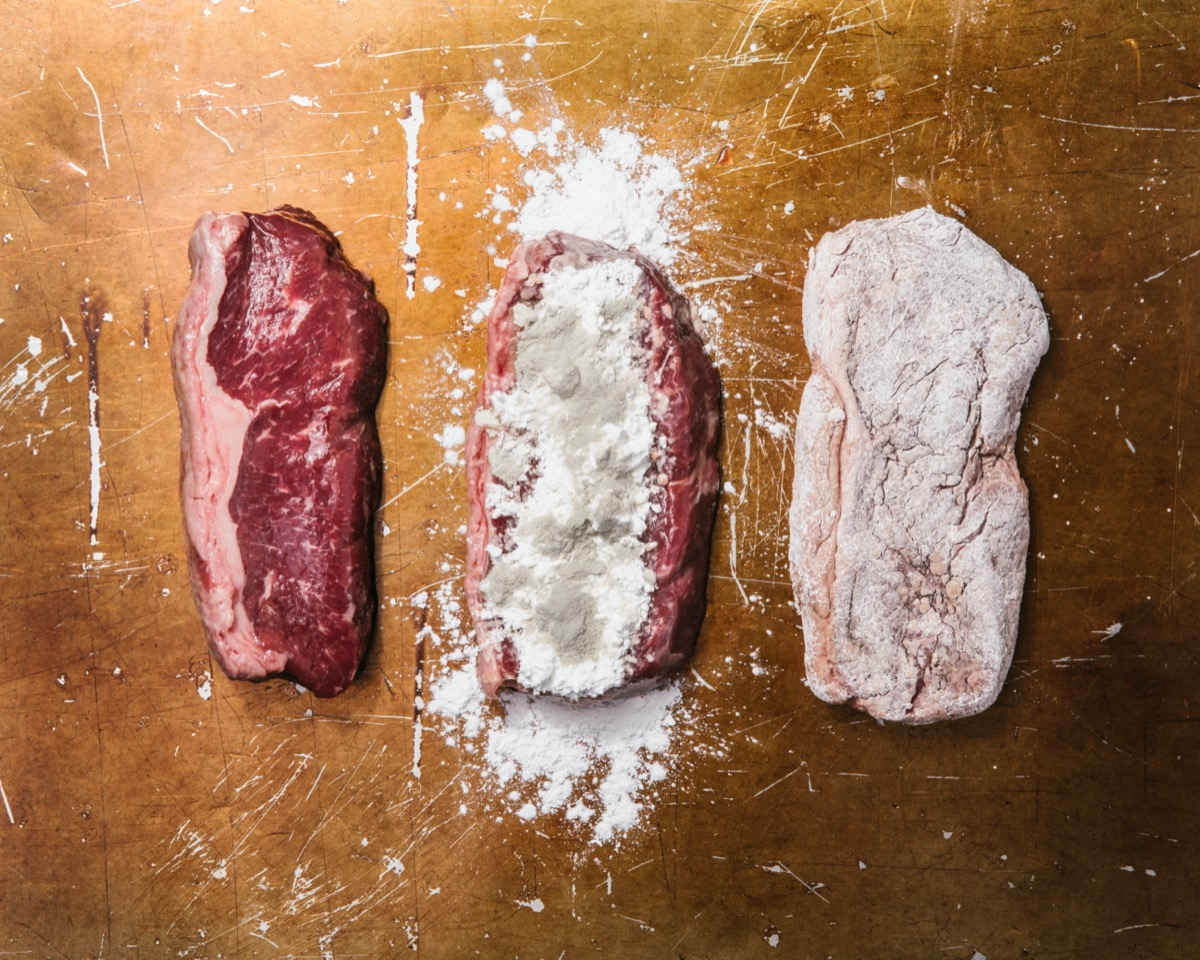 three slices of meat. one is raw and plain, the second is raw and dusting with white powder and brown mold, the third is raw but the seasoning is rubbed in