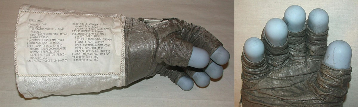 Side view, thumb up, of the left glove from an Apollo 11 spacesuit (left) and close up on the palm and blue finger pads of the same Apollo 11 glove (right)