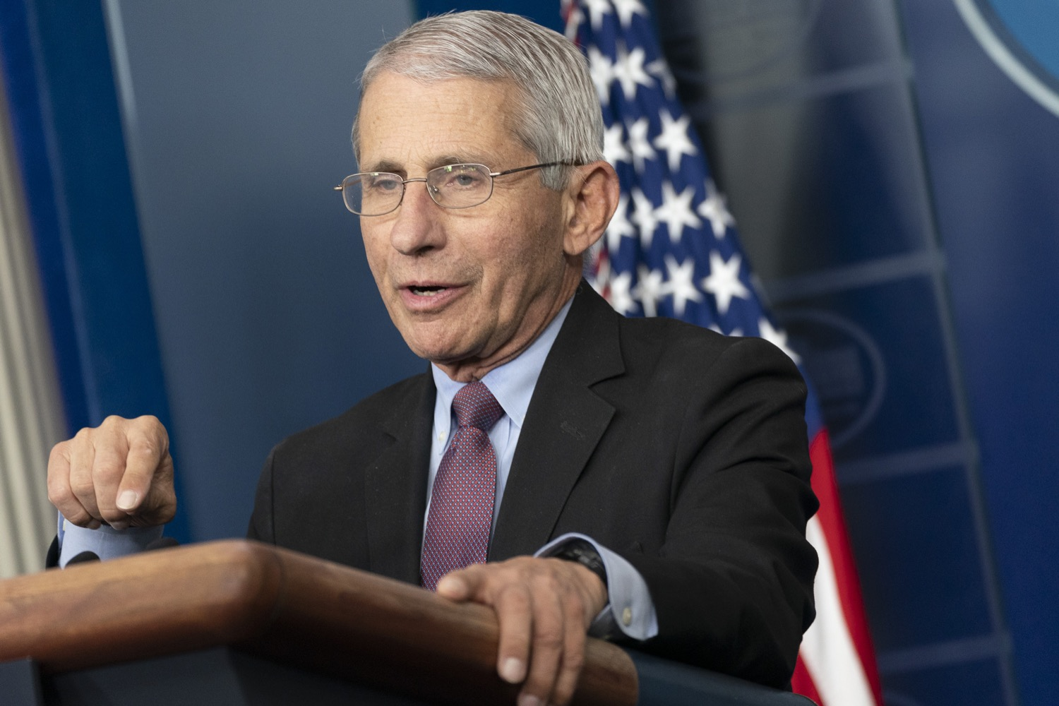 anthony fauci talking at podium at white house press briefing