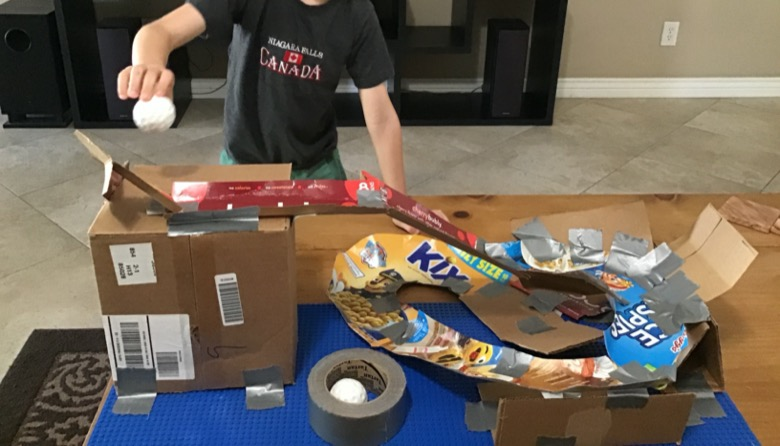 Cardboard roller coaster made out of cereal boxes
