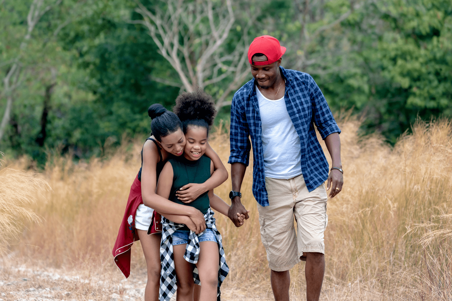 black family hiking in nature