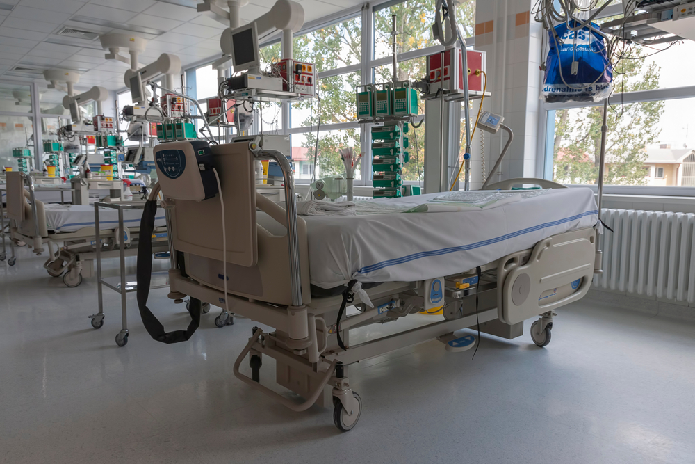 a row of empty hospital beds