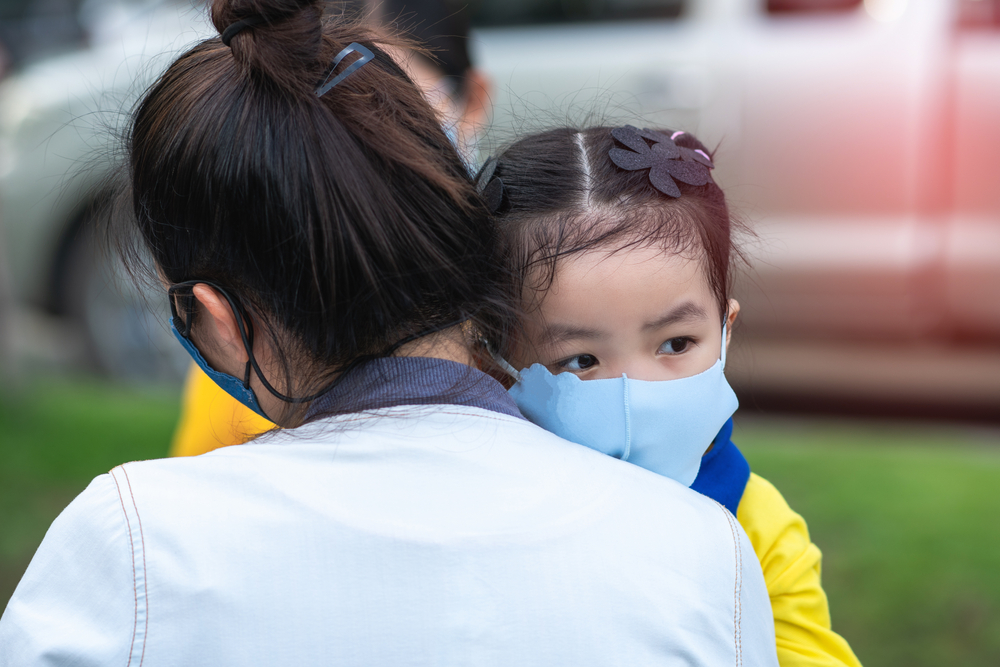 mother and little young daughter wearing mask for prevent the spread of the Covid-19 outdoor