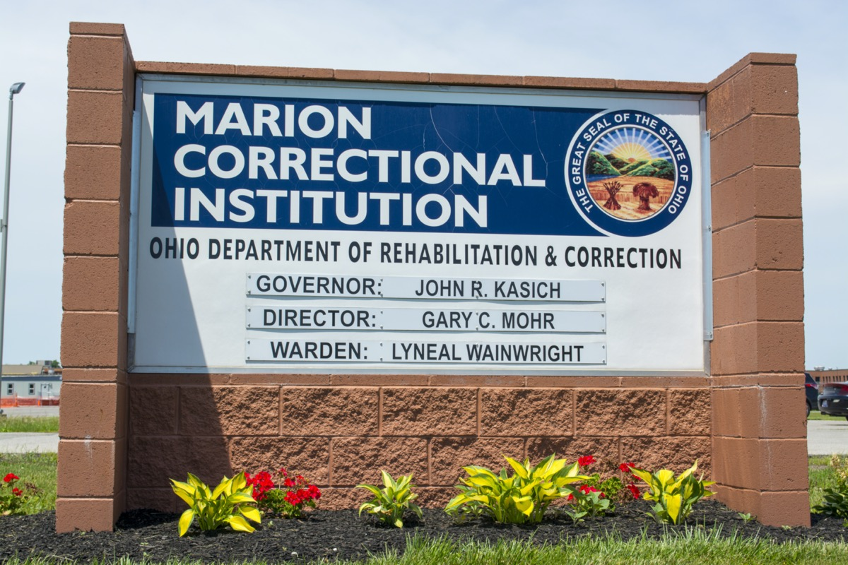 a sign that reads marion correctional institution, ohio department of rehabilitation and corrections