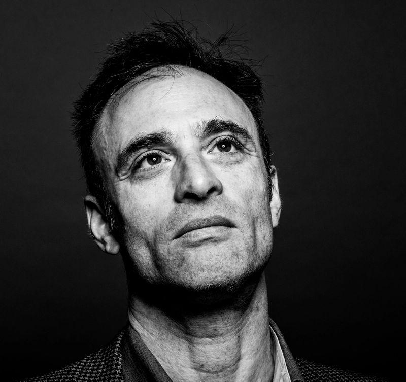 a black and white portrait of a man gazing upward