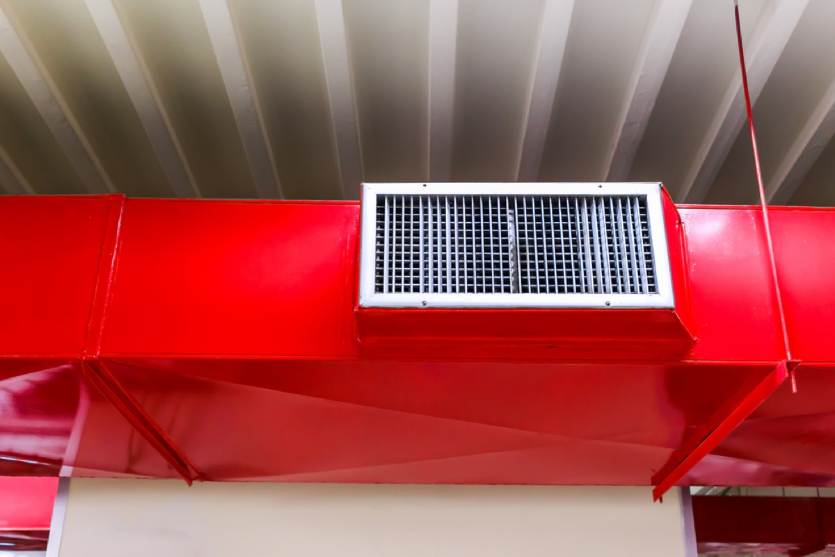 a red air vent inside a building
