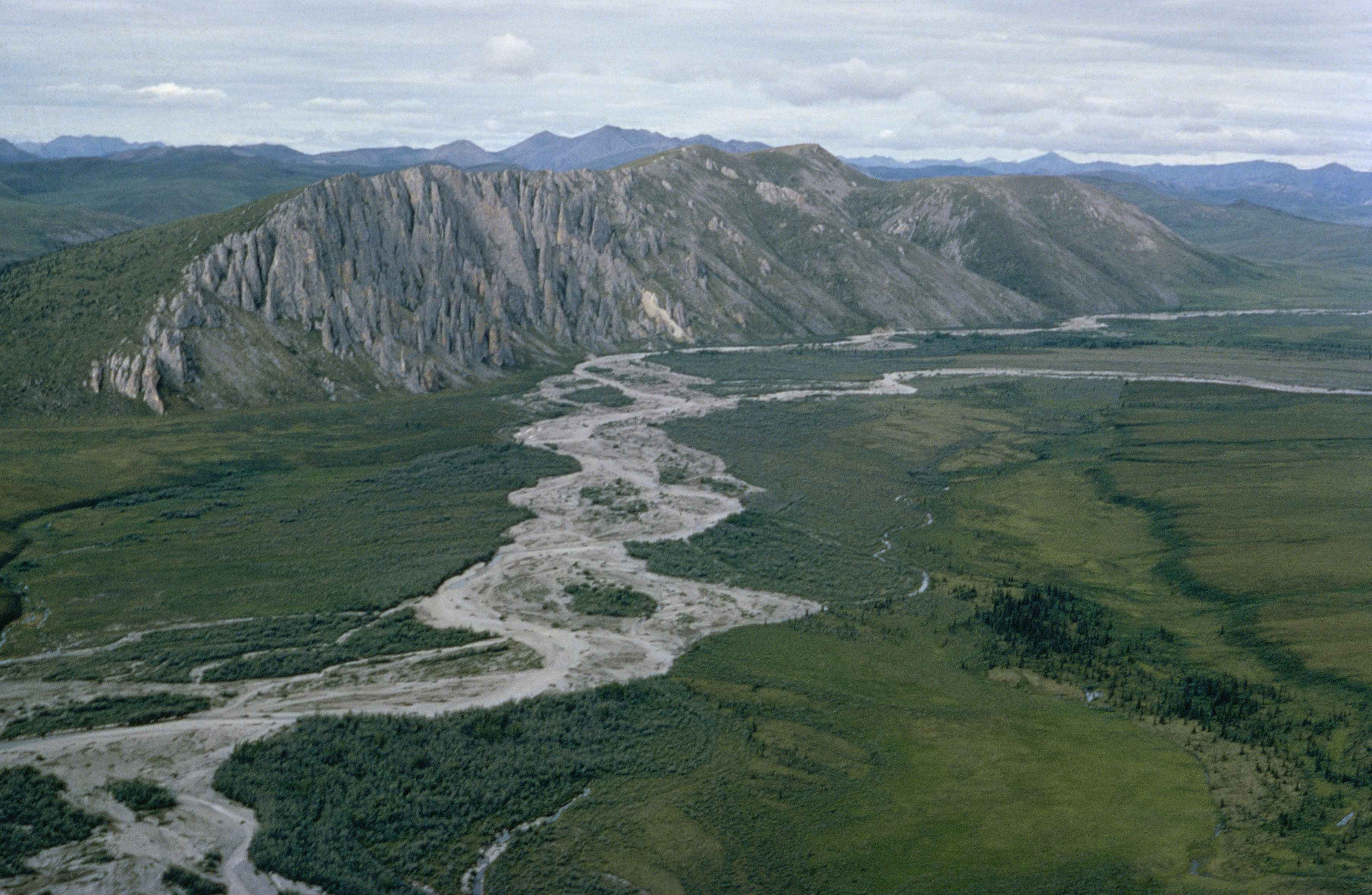 a landscape shot of mountains and a large long river