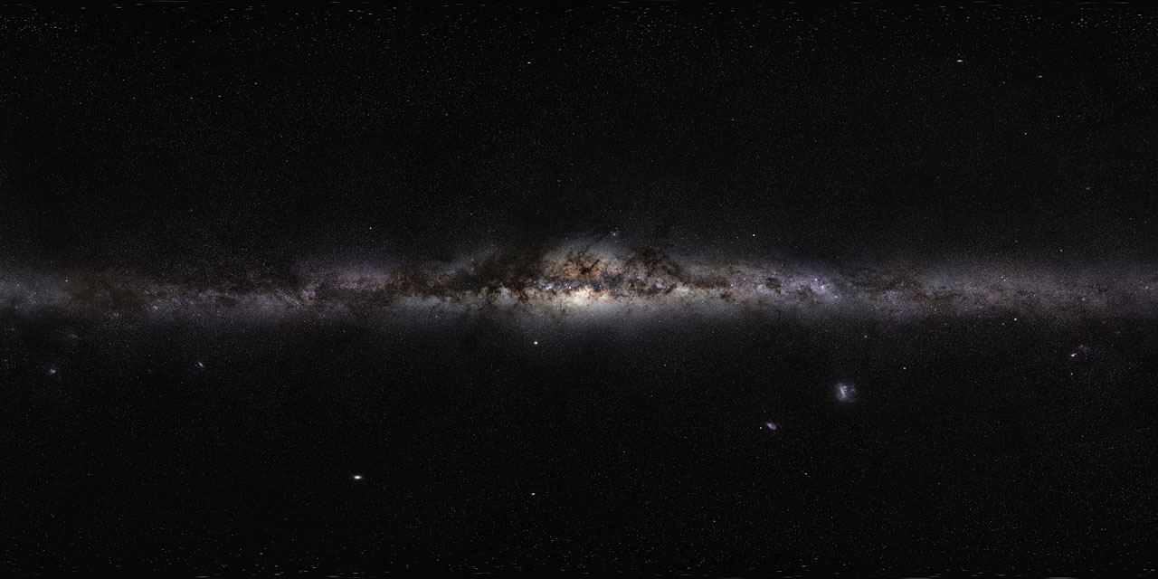 a linear stretch of clouds illuminated by glowing stars. a panoramic view of the milky way galaxy