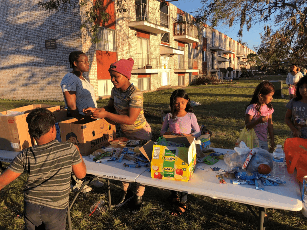 a family at a table full of emergency supplies