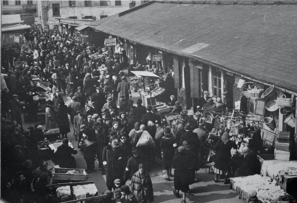 a black and white image of a crowded market in a ghetto