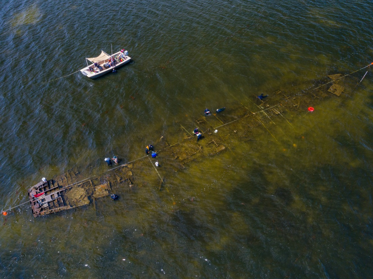 an aerial view of a shipwreck in a shallow bay