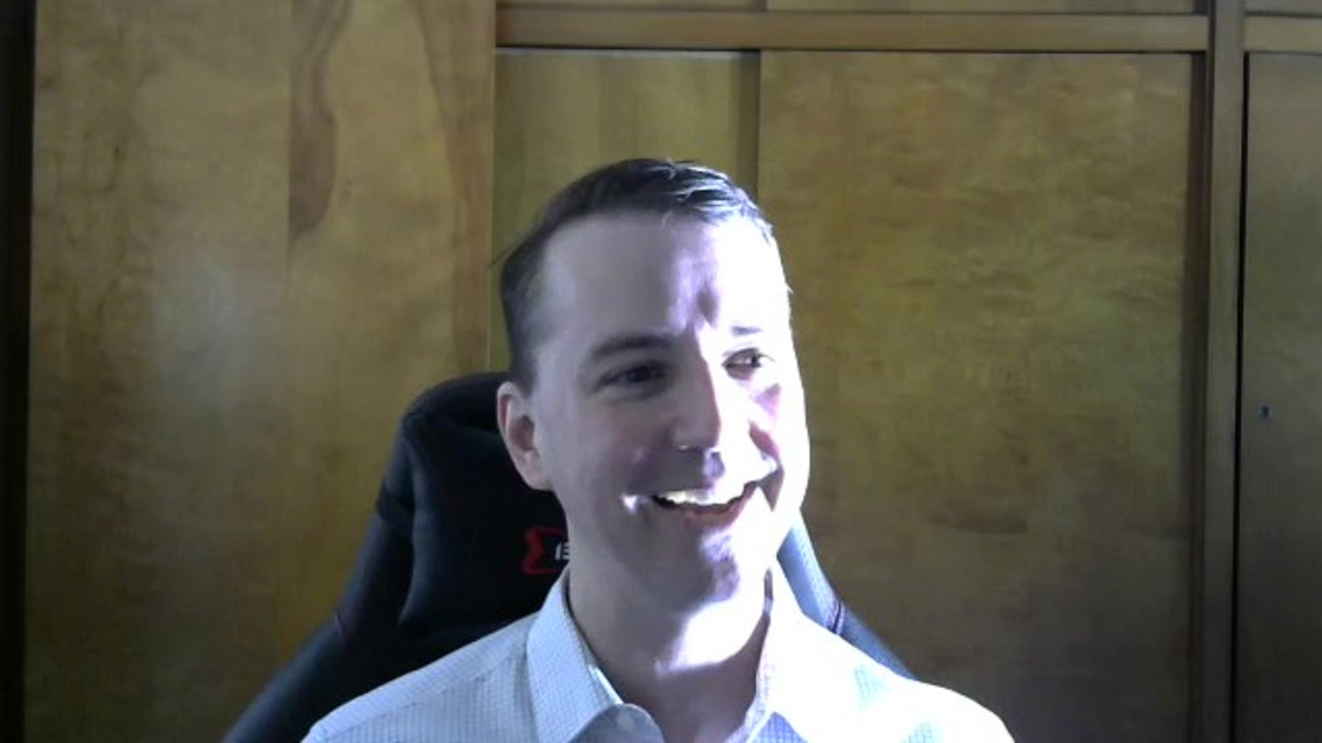 a screenshot of a video chat of a White man talking and smiling