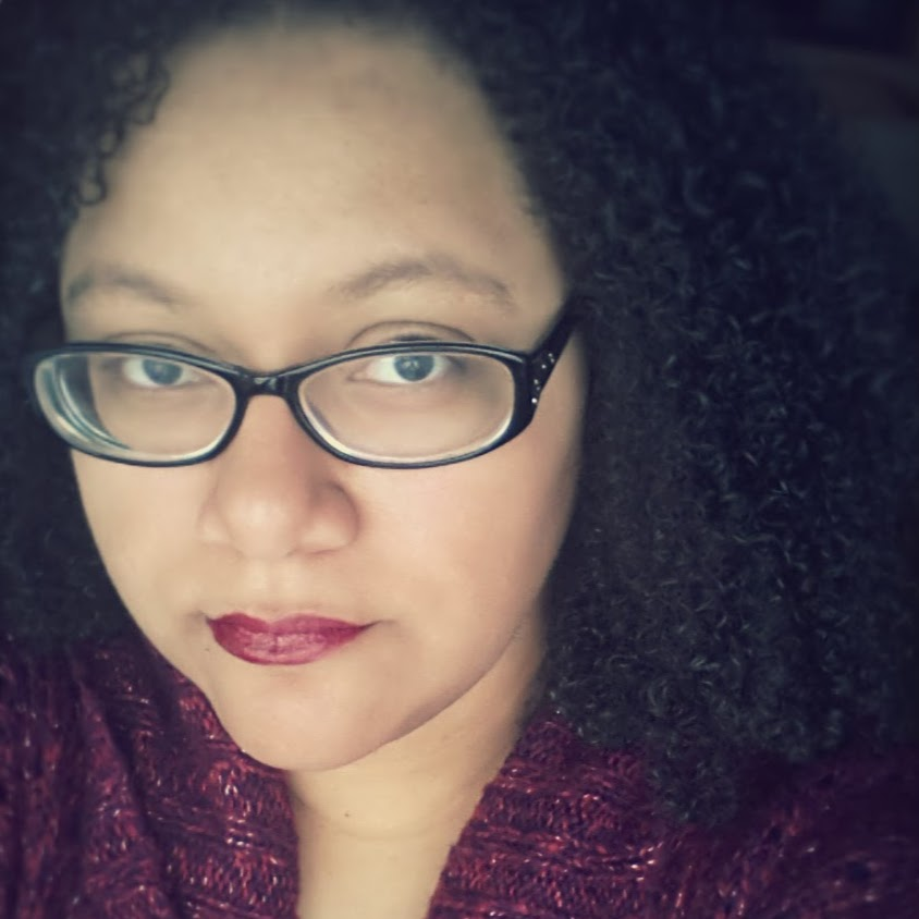 a portrait of a black woman in glasses