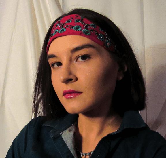 an Indigenous woman wearing a headband