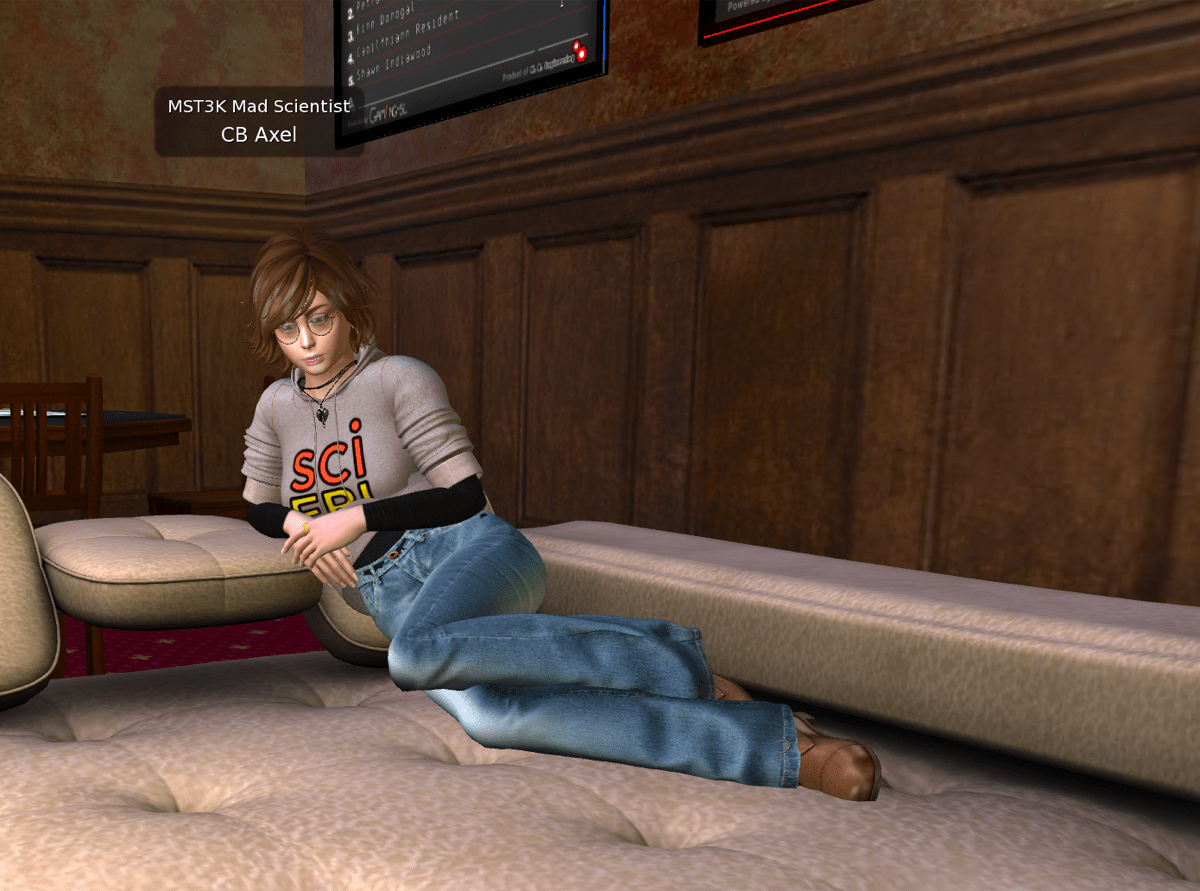 a virtual world avatar woman with a pixie haircut, glasses, and a gray scifri hoodie. she is lounging on a couch