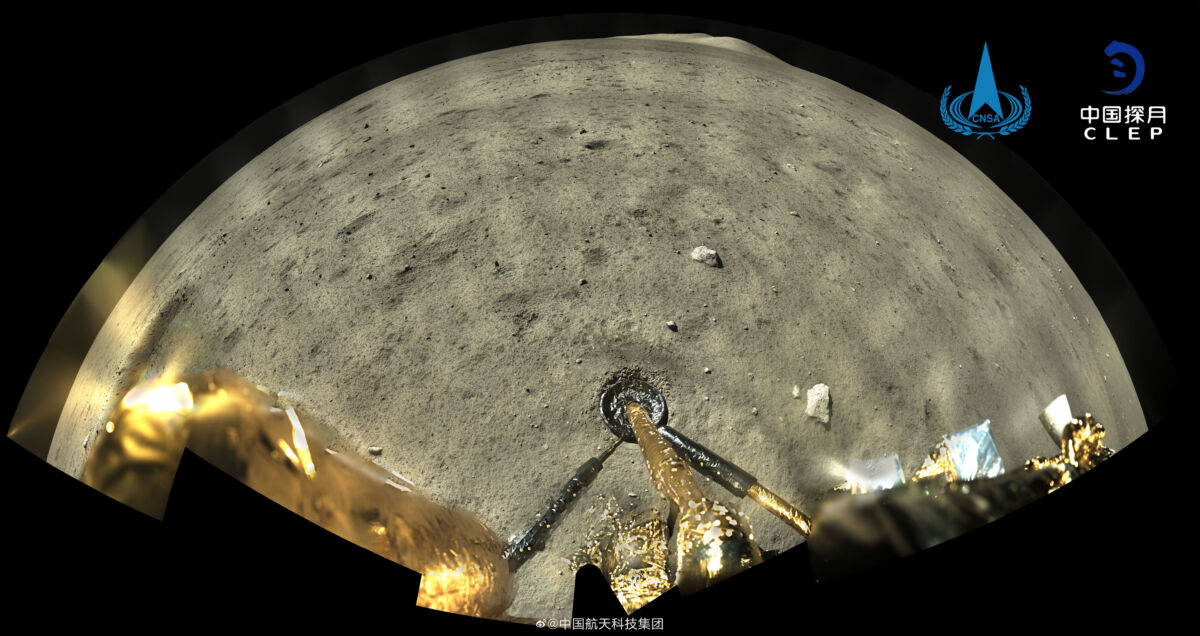 a panoramic image from the chinese lander looking at the surface of the moon and it's landing leg