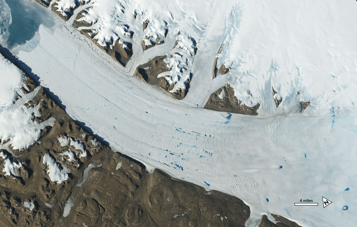 an aerial view of a glacier's movement and its deposit melt