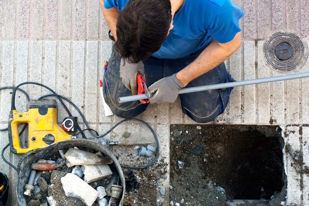 plumber worker repair and replace water pipes because of a break in pipes