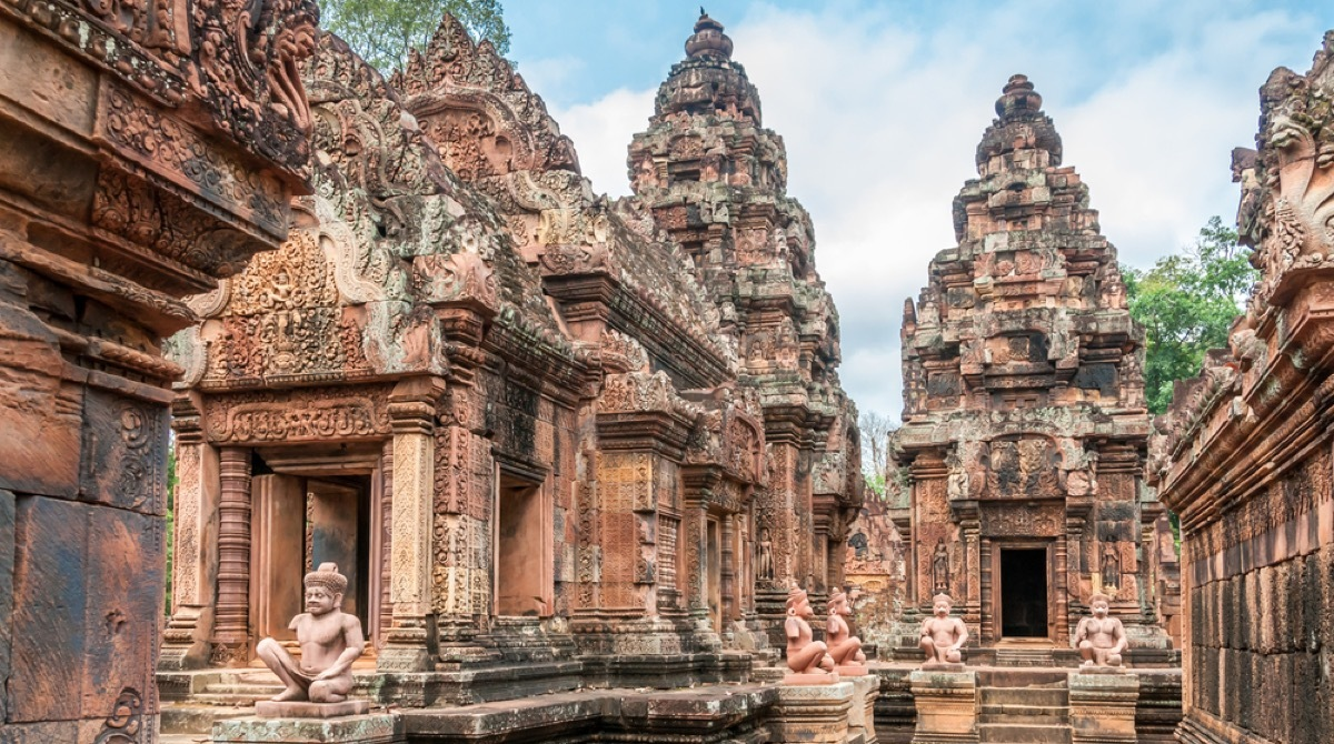 an ancient stone temple with various intricate towers and turrets