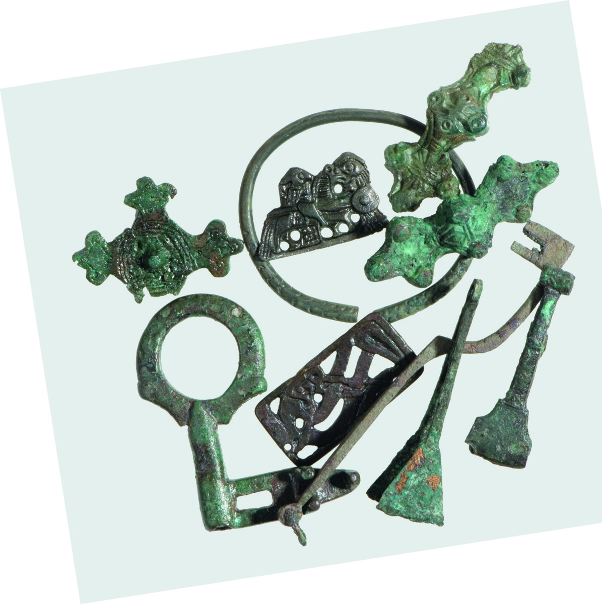 a bunch of decaying artifacts of metal keys, tweezers, brooches, and a ring
