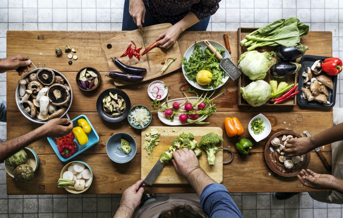 Aerial view of people with fresh vegetables preparing to cook