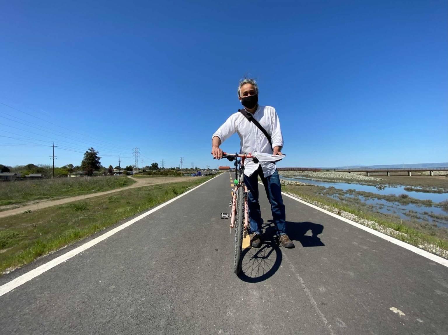 a man on a bike wearing a mask