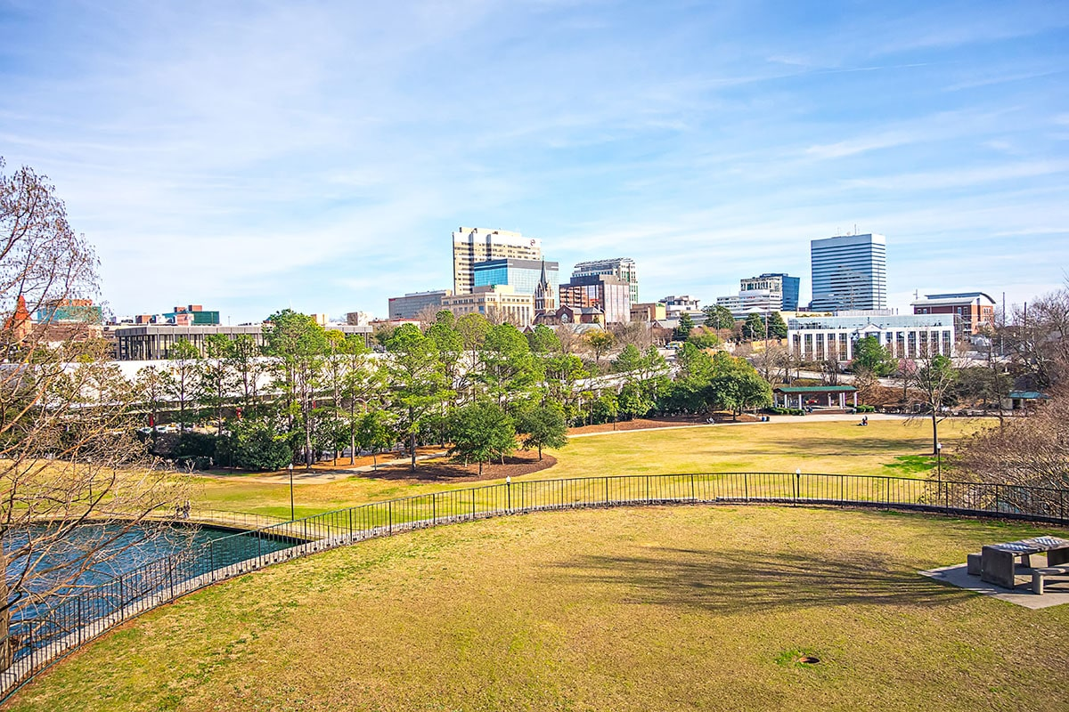 View of the buildings in downtown Columbia, South Carolina from a park.