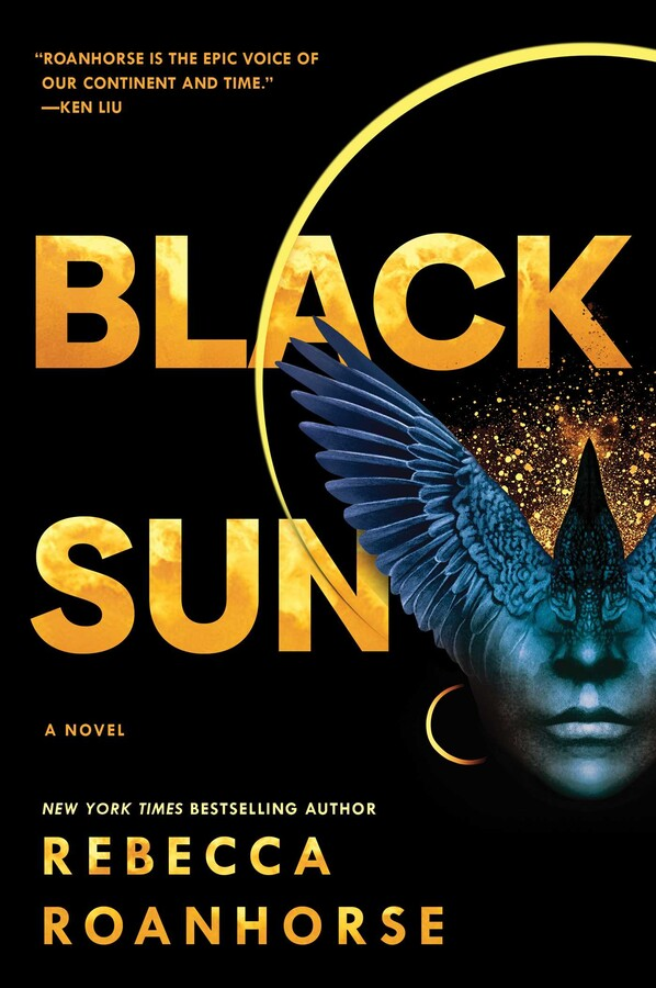 """a primarily black book cover with a person's face only showing a nose and lips with bird like features and wings coming up from above the nose and covering the eyes. there is a yellow halo above the figure. the title reads """"black sun"""" a novel by rebecca roanhorse"""